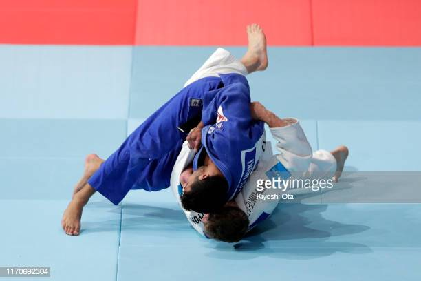 Sagi Muki of Israel throws Matthias Casse of Belgium in the Men's 81 kg final on day four of the World Judo Championships at the Nippon Budokan on...