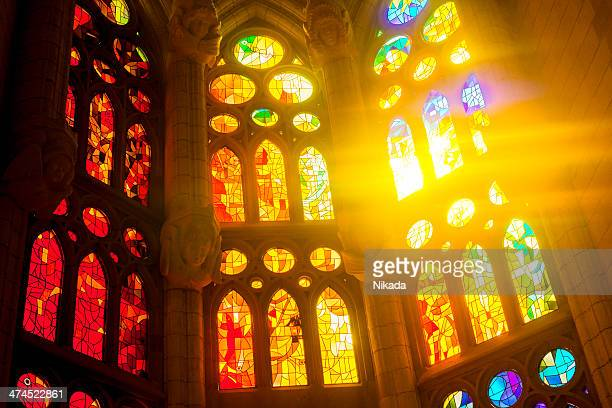 sagrada familia glass window in barcelona - catholicism stock pictures, royalty-free photos & images