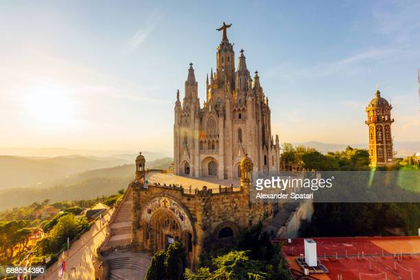 sagrat cor temple at tibidabo mountain during sunset, barcelona, catalonia, spain - barcelona fotografías e imágenes de stock