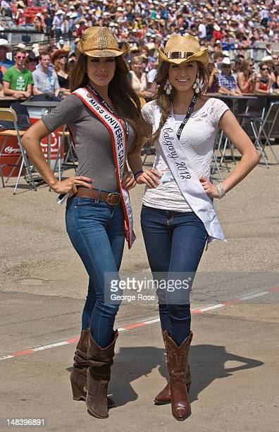 Sahar Biniaz Miss Universe Canada 2012 left and Tonia Van Riel Miss Calgary 2012 pose for pictures during the rodeo on July 6 2012 in Calgary Canada...
