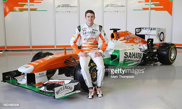 Sahara Force India Formula 1 driver Paul Di Resta of Great Britain with the team's new car for the 2013 Formula 1 season, the VJM06, during the...