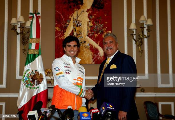Sahara Force India Team Principle Vijay Mallya welcomes Sergio Perez as their new driver on December 12 2013 in London England