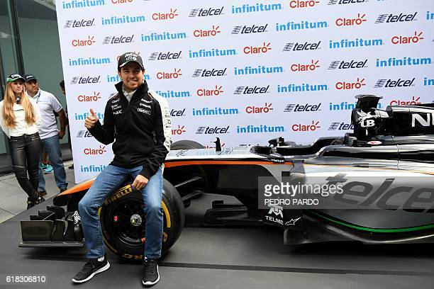 Sahara India Force Mexican driver Sergio 'Checo' Perez poses for pictures after a press conference in Mexico City on October 26 2016 Mexico will hold...