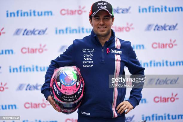 Sahara India Force Mexican driver Sergio 'Checo' Perez poses for pictures after a press conference in Mexico City on October 25 2017 ahead of the...
