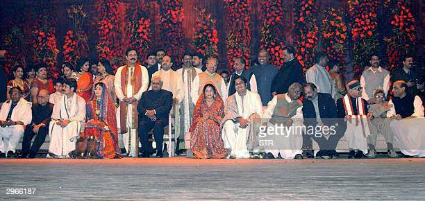 Sahara India group chief Sboroto Roy stands behind Indian Prime Minisiter Atal Behari Vajpayee as politicians Bollywood's who's who and India's...