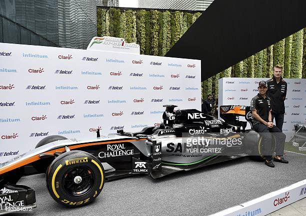 Sahara's Force India team drivers Checo Perez and Nico Hülkenberg pose with a F1 car after a press conference in Mexico City on October 19 2015...