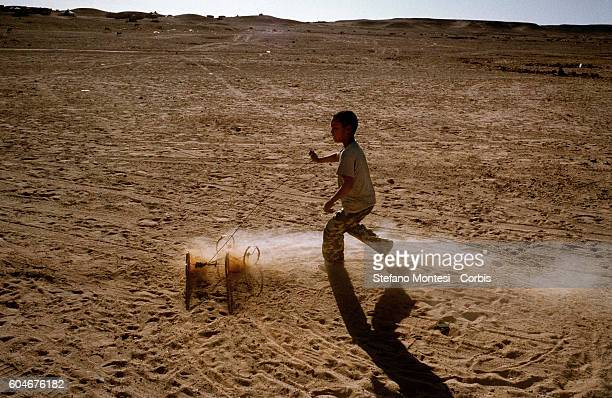 Saharawi child plays with a toy built with poor material in the Saharawi refugee camp Smara on January 14 2008 in Tindouf Algeria