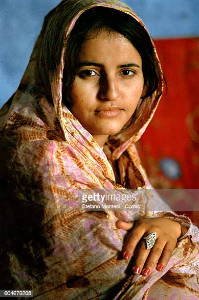 Saharawi girl with Melfa typical dress by women in Western Sahara in the Saharawi refugee camp Smara on January 13 2010 in Tindouf Algeria
