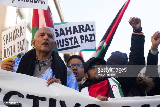 Saharawis shouting slogans during the demonstration. Thousands of Saharawis arrive from all over Spain to demand the end of Morocco's occupation in...