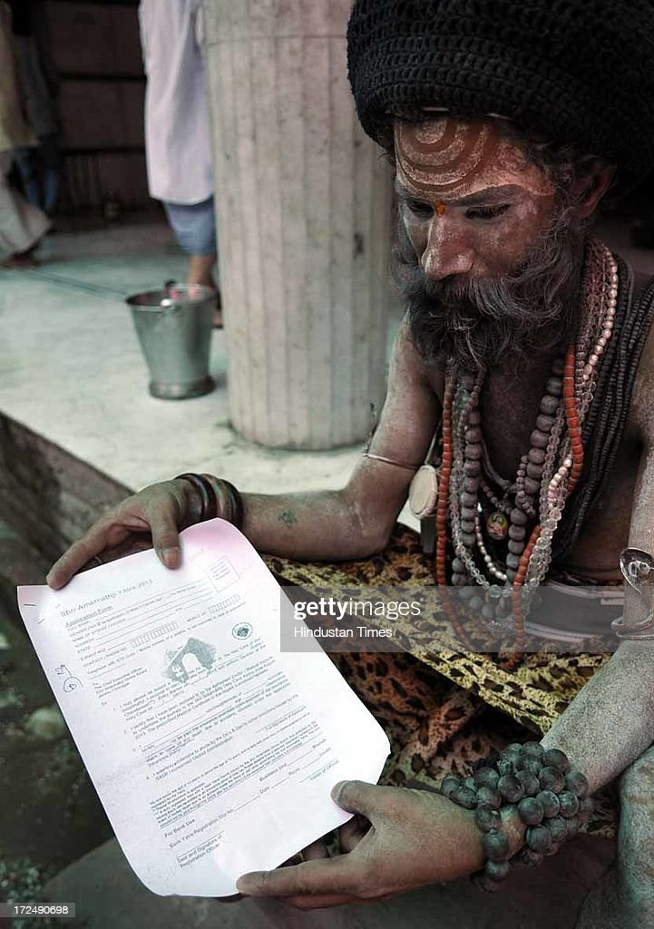 A Sahdu showing his application form for Amarnath Yatra registration for the annual pilgrimage to the Amarnath cave shrine on July 2, 2013 in Jammu, India. Thousands of pilgrims annually visit the remote Himalayan shrine of Amarnath at 3,888 meters (12,756 feet) above sea level to worship an icy stalagmite representing Shiva, the Hindu god of destruction. A small batch of 1,785 devotees today left Jammu base camp for the Amarnath cave shrine. The sixth batch, including 1,395 male, 326 women and 14 children, apart from 50 sadhus, was on its way to twin base camps of Pahalagam and Baltal in Kashmir Valley. Over 50,000 pilgrims have paid obeisance at the cave shrine of Amarnath in south Kashmir till last evening.