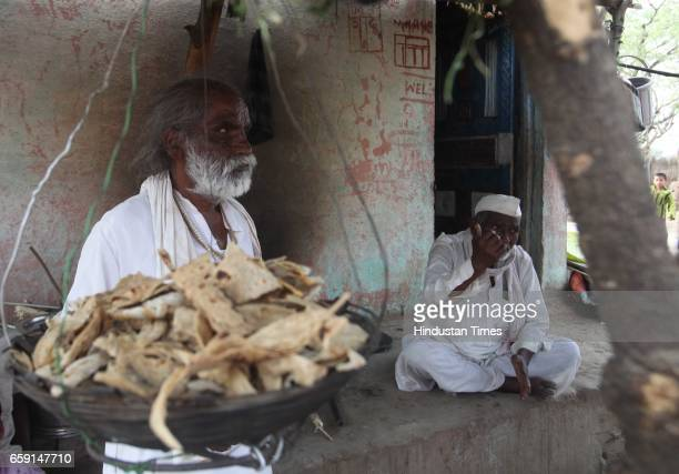 Sahebrao Pisule and his visually challenged son beg for roti and hang it up in a basket so that dogs do not eat it in Rui village Jalna