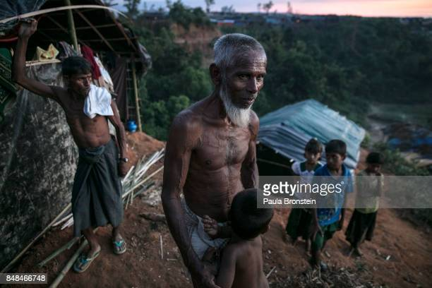 Saheh Ahmad stands outside his makeshift shelter on top of a hill in the overcrowded Balukhali camp September 17 2017 in Balukhali Cox's Bazar...