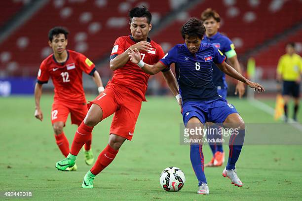 Sahil Suhaimi of Singapore and Sam Ouen Pidor of Cambodia vie for the ball during the 2018 FIFA World Cup Qualifier Group E Match between Singapore...