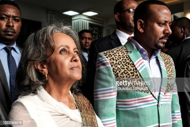TOPSHOT SahleWork Zewde walks with Prime Minister Abiy Ahmed after being elected as Ethiopia's first female President at the Parliament in Addis...