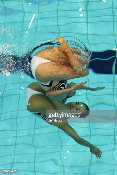 Saho Harada and Emiko Suzuki of Japan compete in the Synchronised Swimming Duet Free Routine Preliminary at the National Aquatics Center on Day 11 of...