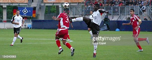 Sahr Senesie puts the boot in on Abdelaziz Tawfik at The Enschede Stadium Enschede Netherlands on June 11 2005