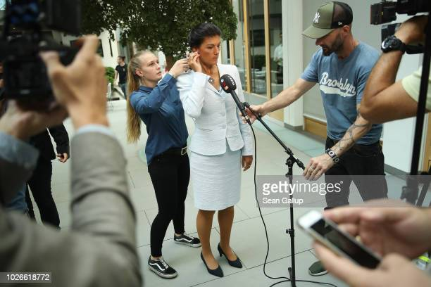 Sahra Wagenknecht Bundestag faction leader of Die Linke leftist political party prepares to give an interview after she and others presented a new...