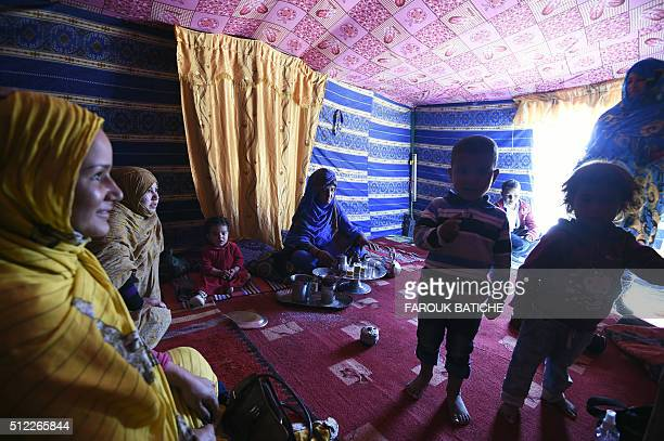 A Sahrawi family gathers inside their tent in the Smara refugee camp in Algeria's Tindouf province on February 25 2016 / AFP / Farouk Batiche
