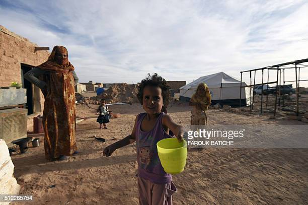 A Sahrawi girl offers the photographer water in the Smara refugee camp in Algeria's Tindouf province on February 25 2016 / AFP / Farouk Batiche