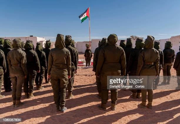 Sahrawi military cadets of the Sahrawi Armed Forces' Military Academy for women only pay tribute to the Sahrawi flag in the courtyard of the Academy...