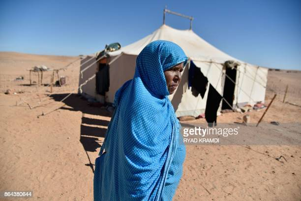 Sahrawi refugee Khelifa Maleh walks past her tent at the Boujdour camp for Sahrawi refugees on the outskirts of Tindouf south west of Algeria on...
