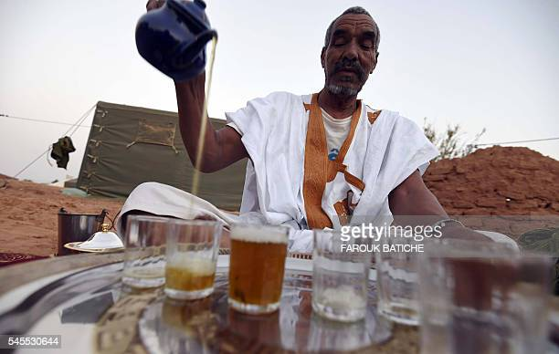 A Sahrawi refugee prepares tea on July 8 2016 at the Sahrawi refugee camp of Dakhla 170 kms to the southeast of the Algerian city of Tindouf in the...