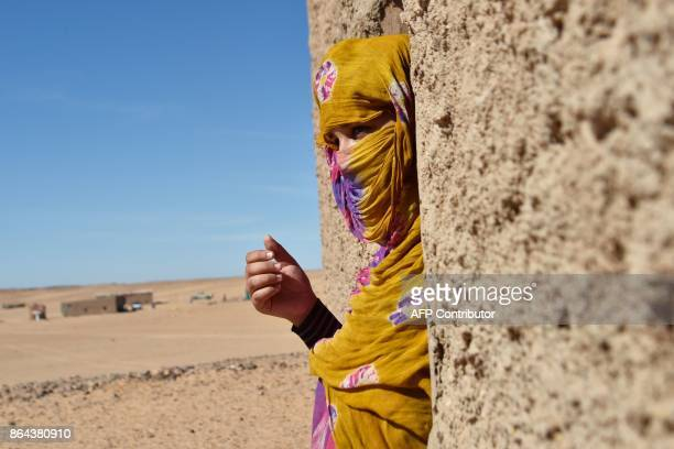 Sahrawi refugee Selembouha Dadi stands at her house at the Boujdour camp for Sahrawi refugees on the outskirts of Tindouf south west of Algeria on...