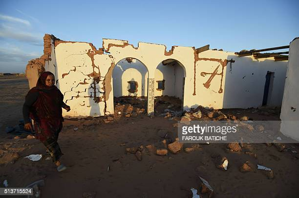 A Sahrawi refugee woman stands next to her house which was destroyed during heavy rain last year at the Boujdour refugee camp west of the Algerian...