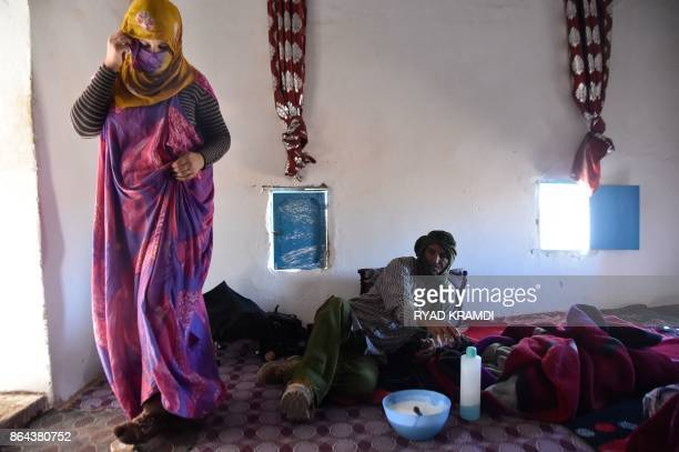 Sahrawi refugees Selembouha Dadi and Ahmed Moulay Dadi are seen in their house at the Boujdour camp for Sahrawi refugees on the outskirts of Tindouf...