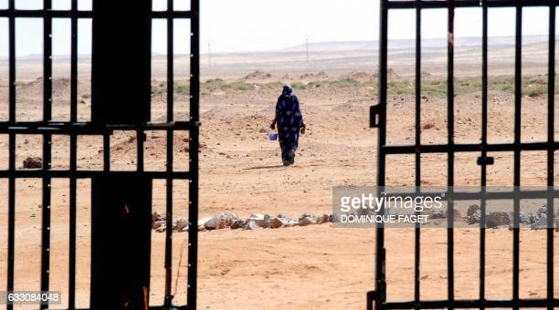 A Sahrawi woman walks in the desert on March 1 2011 near the Western Sahara refugees camp called 27 February in Tindouf Western Sahara is a former...