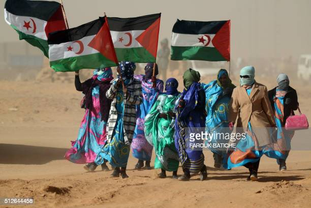 Sahrawi women hold Polisario Front's flags during a ceremony to mark 40 years after the Front proclaimed the Sahrawi Arab Democratic Republic in the...