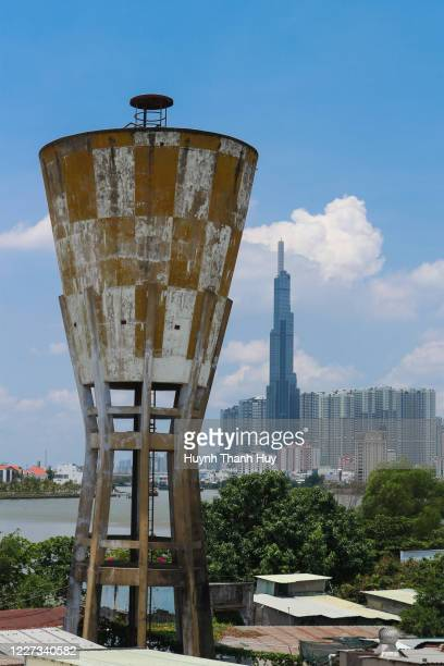 sai gon old water tower and landmark 81 building - saigon river stock pictures, royalty-free photos & images