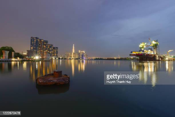 sai gon river by night with a view of thu thiem no.2 bridge - saigon river stock pictures, royalty-free photos & images