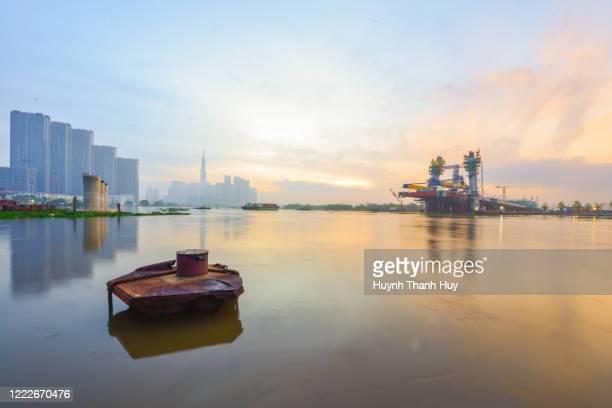 sai gon river by sunrise - thu thiem no.2 bridge in ho chi minh city - saigon river stock pictures, royalty-free photos & images