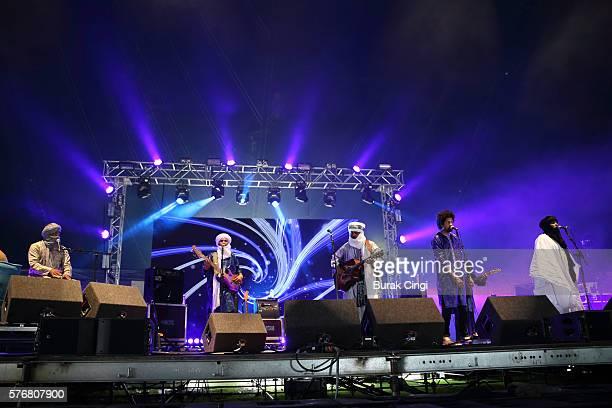 Said Ag Ayad Eyadou Ag Leche Abdallah Ag Alhousseyni Elaga Ag Hamid and Ibrahim Ag Alhabib of Tinariwen perform live on stage at Citadel Festival at...