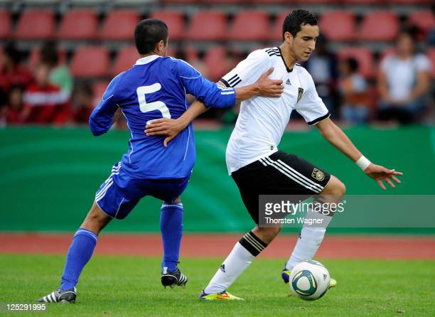 Said Benkarit of Germany battles for the ball with Deen Saief of Israel during the DFB U17 Four Nations Cup match between Germany and Israel at Aue...