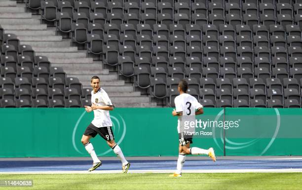Said Benkarit of Germany celebrates after he scores his team's opening goal during the international friendly match between the U 16 teams of Germany...