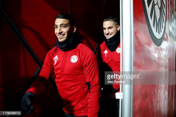 Said Benrahma and Daniel Bentley of Brentford make their way out to warm up during the Sky Bet Championship match between Brentford and Aston Villa...