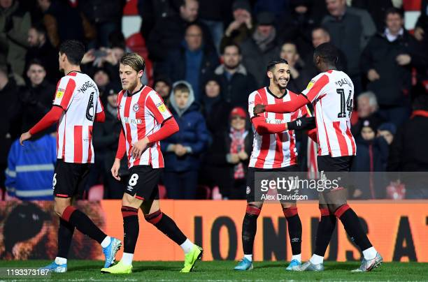 Said Benrahma and Joshua Dasilva of Brentford celebrate their sides first goal during the Sky Bet Championship match between Brentford and Cardiff...