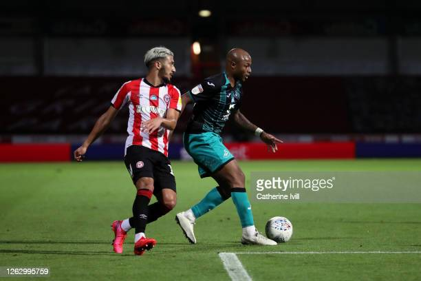 Said Benrahma of Brentford and Andrew Ayew of Swansea City during the Sky Bet Championship Play Off Semifinal 2nd Leg match between Brentford and...