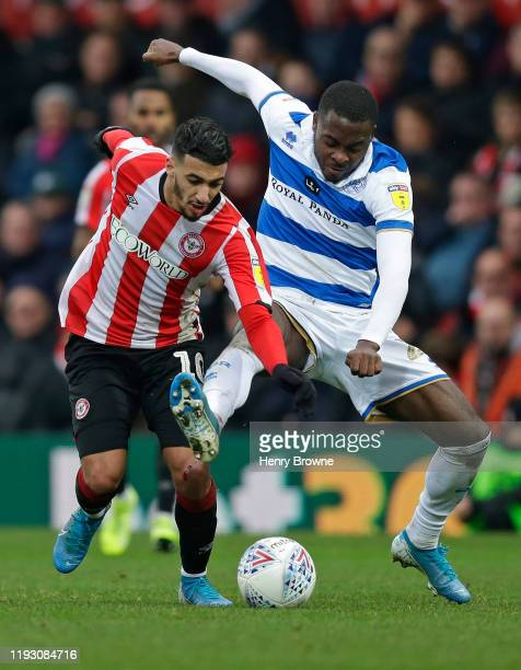 Said Benrahma of Brentford and Bright OsayiSamuel of Queens Park Rangers during the Sky Bet Championship match between Brentford and Queens Park...