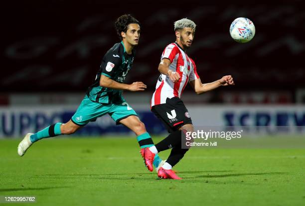 Said Benrahma of Brentford and Yan Dhanda of Swansea during the Sky Bet Championship Play Off Semifinal 2nd Leg match between Brentford and Swansea...