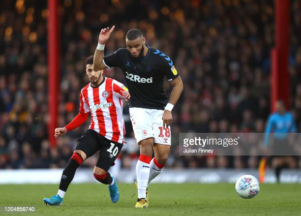 Said Benrahma of Brentford battles for possession with Harold Moukoudi of Middlesborough during the Sky Bet Championship match between Brentford and...