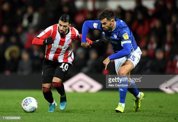 Said Benrahma of Brentford battles for possession with Marlon Pack of Cardiff City during the Sky Bet Championship match between Brentford and...