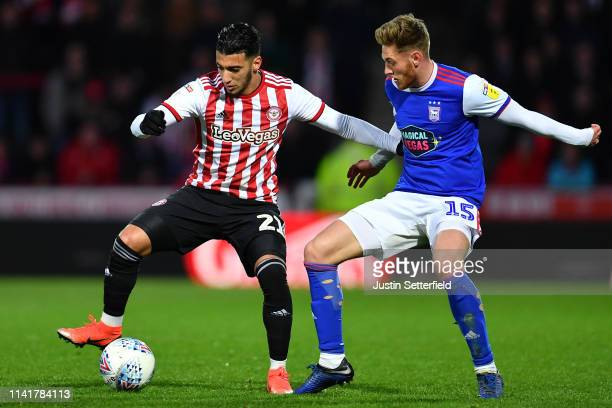 Said Benrahma of Brentford holds off Teddy Bishop of Ipswich Town during the Sky Bet Championship match between Brentford and Ipswich Town at Griffin...