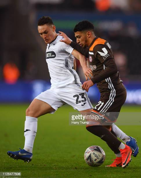 Said Benrahma of Brentford is challenged by Connor Roberts of Swansea City during the FA Cup Fifth Round match between Swansea and Brentford at...