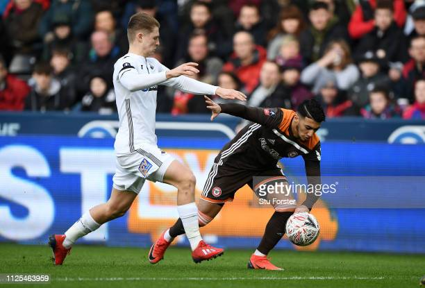 Said Benrahma of Brentford is challenged by George Byers of Swansea City during the FA Cup Fifth Round match between Swansea and Brentford at Liberty...
