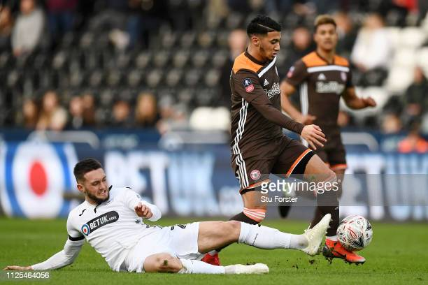 Said Benrahma of Brentford is challenged by Matt Grimes of Swansea City during the FA Cup Fifth Round match between Swansea and Brentford at Liberty...
