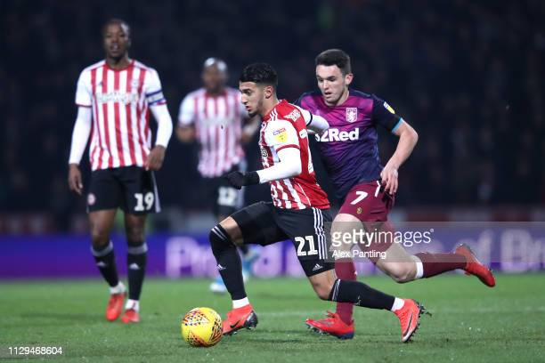 Said Benrahma of Brentford is closed down by John McGinn of Aston Villa during the Sky Bet Championship match between Brentford and Aston Villa at...