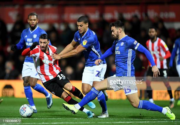 Said Benrahma of Brentford is tackled by Lee Peltier and Marlon Pack of Cardiff City during the Sky Bet Championship match between Brentford and...